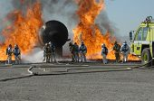 image of firehose  - Firefighters train for battling an aircraft fire - JPG