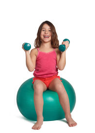 picture of lifting weight  - Elementary age girl having fun exercising with weights - JPG