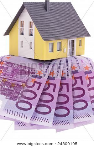 many euro bills and a house
