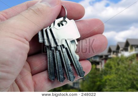 Real Estate Agent Hands Over The Keys.