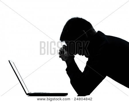 one caucasian business man computing computer laptop despair sad portrait silhouette in studio isolated on white background