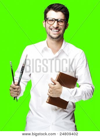 young student holding book against a removable chroma key background