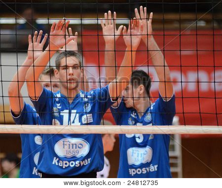 KAPOSVAR, HUNGARY - OCTOBER 29: Roland Vajda (14) in action at a Hungarian National Championship volleyball game Kaposvar (blue) vs. Szolnok (red), October 29, 2011 in Kaposvar, Hungary.