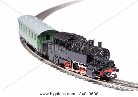 Toy steam train pulling one carriage
