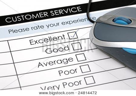 Tick placed in excellent check box on customer service satisfaction survey form with computer mouse