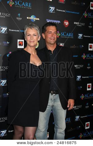 LOS ANGELES - OCT 30:  Jamie Lee Curtis, Malek Akkad  arrives at the sCare Foundation Halloween Launch Benefit at Conga Room - LA Live on October 30, 2011 in Los Angeles, CA