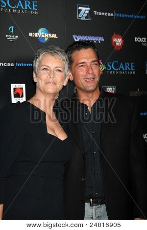 LOS ANGELES - OCT 30:  Jamie Lee Curtis, Malek Akkad arrive at the sCare Foundation Halloween Launch Benefit at Conga Room - LA Live on October 30, 2011 in Los Angeles, CA