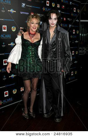 LOS ANGELES - OCT 30:  Donna Keegan & Son  arrive at the sCare Foundation Halloween Launch Benefit at Conga Room - LA Live on October 30, 2011 in Los Angeles, CA