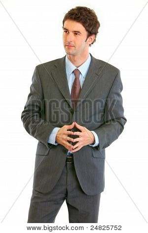 Thoughtful Modern Businessman Looking In Corner