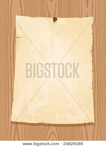 aged vintage paper on wooden background