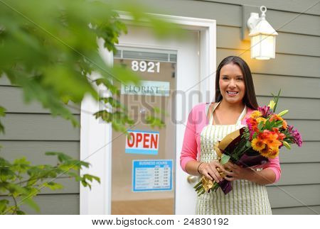 Florist in front of shop with flowers