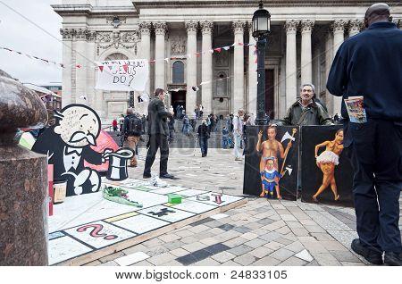 LONDON, UK -OCTOBER 31: Painter 'Kaya Mar' exhibiting his work next to Banksy's Monopoly sculpture on October 31, 2011 in London.