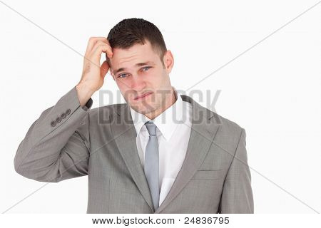 Anxious young businessman against a white background