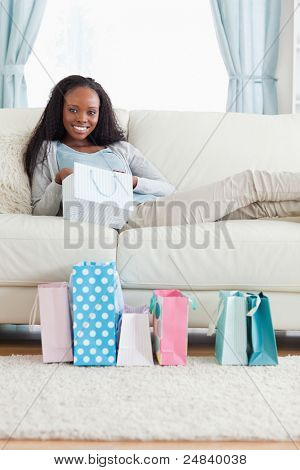 Smiling woman taking a moment off after shopping
