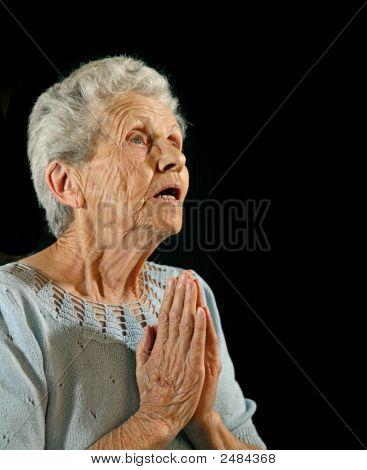 Worshipping Elderly Woman