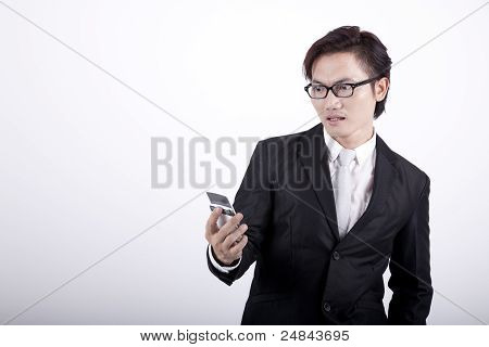 Shocked Businessman With A Cellphone