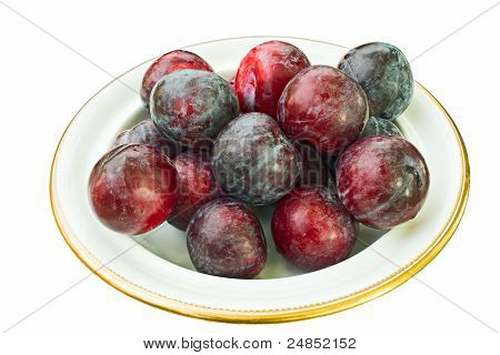 Dish Full Of Whole, Ripe Plums, Covered With Natural Wax Bloom
