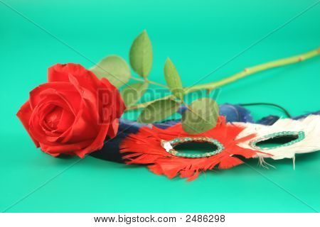A Red Rose And A Carnival Mask