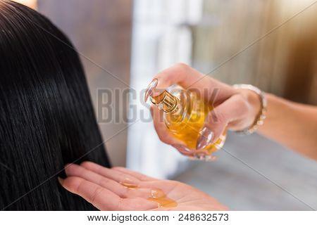 poster of Oil Hair Treatment For Woman. Spa, Beauty Salon. Hair Care In Modern Spa Salon. Hairdresser Woman Ap