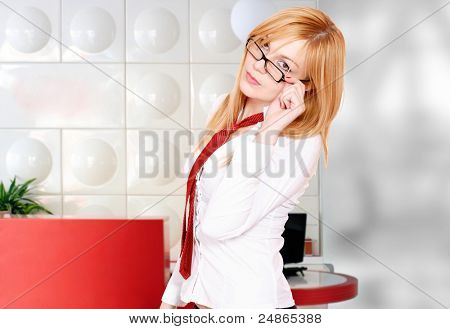 Closeup of a young smiling business man woman in a light and mordern business environement
