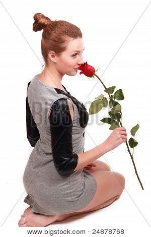 lovely girl holds red rose