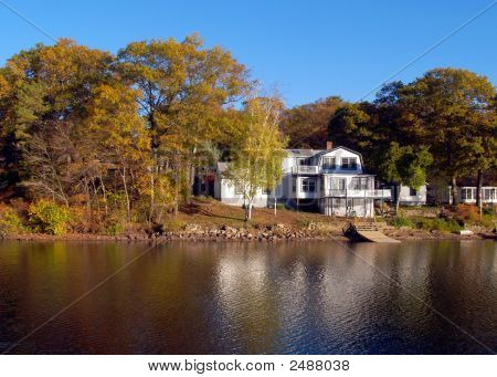Waterfront House, Autumn Trees Mirrored In  Pond Water