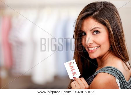 Female shopper at a clothing store on sale