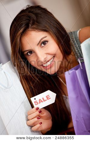 Shopping woman at a clothing store buying on sale