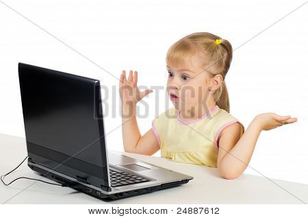 Little girl playing on the computer.