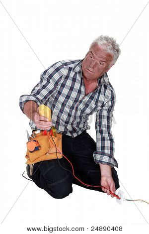 An electrocuted tradesman staring at his multimeter