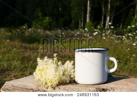 poster of White Campfire Enamel Mug Mockup With White Flowers