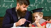 Individual Schooling Concept. Father With Beard, Teacher Teaches Son, Little Boy. Kid Studies Indivi poster