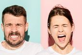 Closeup Portrait Of Young Couple, Man, Woman. One Being Excited Happy Smiling, Other Serious, Concer poster