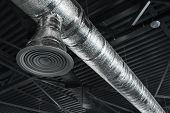 Ventilation System On The Ceiling Of Large Buildings. Ventilation Pipes In Silver Insulation Materia poster