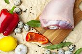 Raw Turkey Thigh Garlic Apples Lemon Red Bell Pepper Quail Eggs Spices On A Wooden Board. Top View O poster