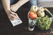 Weight Loss, Healthy Lifestyle, Diet And People Concept. Close Up Of Overweight Woman Writing Diet P poster