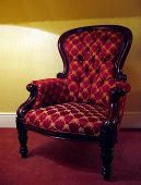 stock photo of 1700s  - Old beautifu redl armchair with soft light - JPG