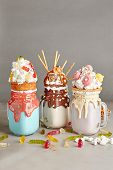 Set of Milk Monster Shakes or Freak Shake. Big Crazy Milkshake or Freakshake with Treats and Sweets  poster