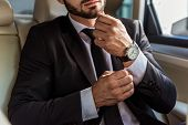 Cropped Image Of Businessman Buttoning Cuff In Car poster