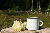 White Campfire Enamel Mug Mockup With White Flowers poster