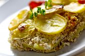 foto of ouzo  - baked moussaka dish on a wooden board - JPG