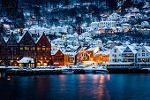 Panorama of historical buildings of Bergen at Christmas time. View of old wooden Hanseatic houses in poster