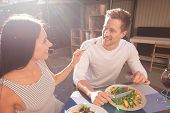 Summer Evening. Beaming Man And Woman Enjoying Nice Summer Evening Together While Eating Tasty Fresh poster