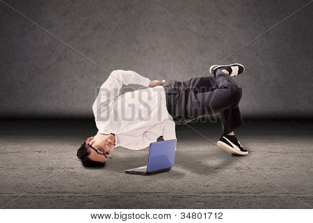 Businessman Breakdancing With Laptop