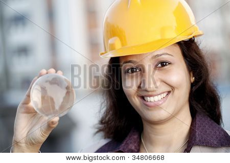 Indian Construction Engineer Holding Globe