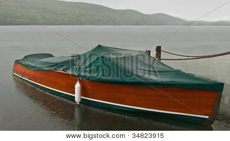 Covered Boat in the Rain