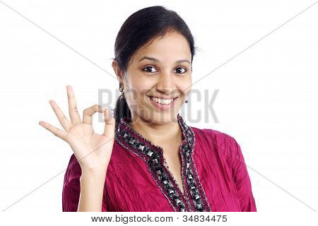 Happy Young Woman With Ok Sign