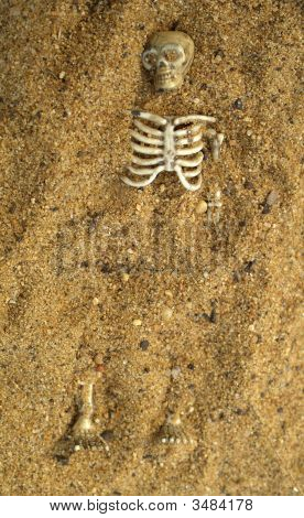 Buried Skeleton In The Sand