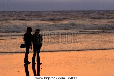 Women Watching The Beach Sunset