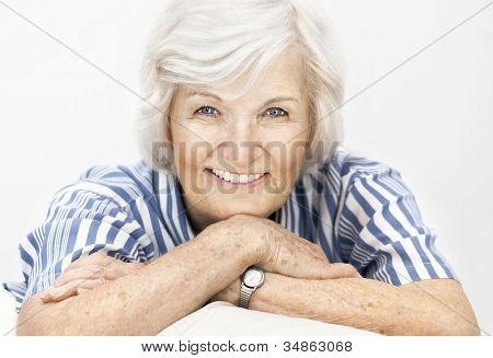 Senior woman portrait, on white background with white hair ,smiling happy to camera